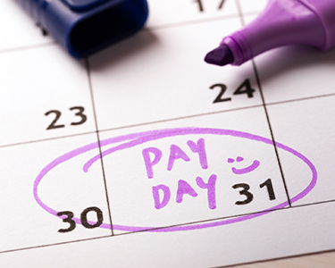 Calendar with pay day written in purple marker and circled