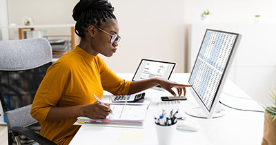 Woman looking at spreadsheets on a computer