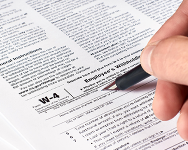 Man filling out W-4 form